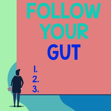 Writing note showing Follow Your Gut. Business concept for Listen to intuition feelings emotions conscious perception Back view young woman watching blank big rectangle