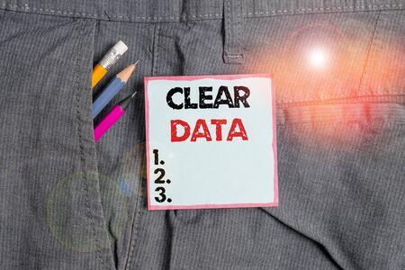 Writing note showing Clear Data. Business concept for act of removing unwanted data or information in a storage disk Writing equipment and blue note paper in pocket of trousers Reklamní fotografie