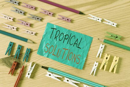 Conceptual hand writing showing Turnkey Solutions. Concept meaning immediately easily ready to use upon implementation Colored crumpled papers wooden floor background clothespin