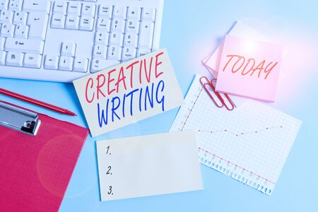 Text sign showing Creative Writing. Business photo showcasing fiction or poetry which displays imagination or invention Paper blue desk computer keyboard office study notebook chart numbers memo