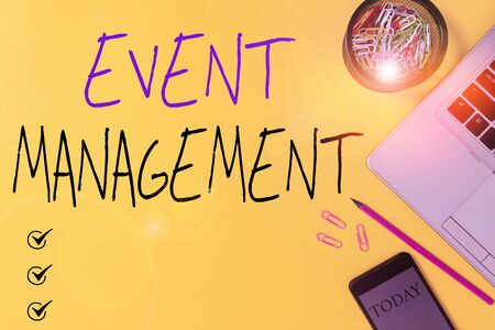 Text sign showing Event Management. Business photo showcasing job of planning and analysisaging large events or conferences Slim trendy laptop pencil smartphone clips container colored background