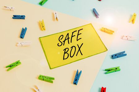 Word writing text Safe Box. Business photo showcasing A small structure where you can keep important or valuable things Colored clothespin paper empty reminder yellow blue floor background office