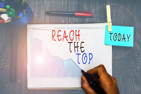 Writing note showing Reach The Top. Business concept for Get Ahead Succeed Prosper Thrive for the Win Victory 版權商用圖片