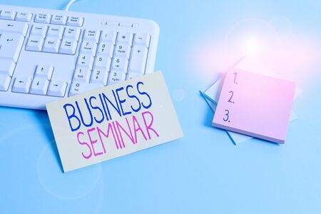 Text sign showing Business Seminar. Business photo text discussion in a small group in which the result of research Paper blue desk computer keyboard office study notebook chart numbers memo