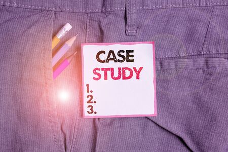 Writing note showing Case Study. Business concept for research methodology that has commonly used in social sciences Writing equipment and blue note paper in pocket of trousers