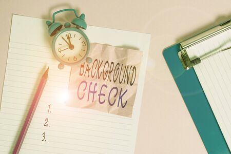 Handwriting text writing Background Check. Conceptual photo investigation into a demonstrating s is origins and previous history Paper sheet note clipboard pencil vintage alarm clock colored background Reklamní fotografie