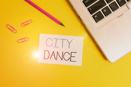 Word writing text City Dance. Business photo showcasing activity of dancing for pleasure or in order to entertain others Trendy metallic laptop clips pencil squared paper sheet colored background
