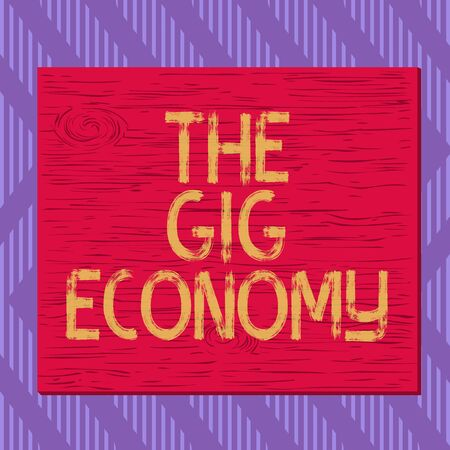 Text sign showing The Gig Economy. Business photo text Market of Shortterm contracts freelance work temporary Square rectangle unreal cartoon wood wooden nailed stuck on coloured wall Foto de archivo