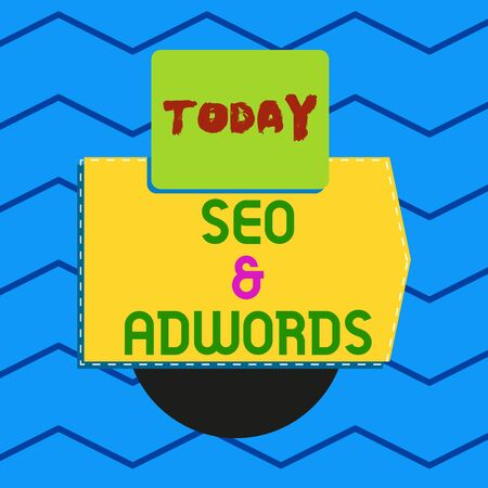 Writing note showing Seo And Ad words. Business concept for Pay per click Digital marketing Ad sense Electronic device with non symmetrical triangle for printing