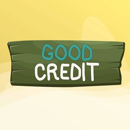 Writing note showing Good Credit. Business concept for borrower has a relatively high credit score and safe credit risk Wooden board rectangle shaped wood attached color background