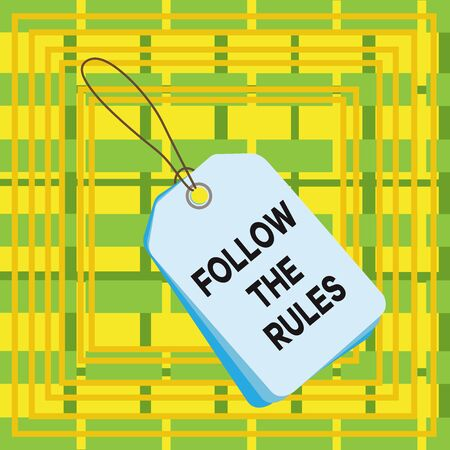 Text sign showing Follow The Rules. Business photo showcasing order someone stick to certain place country guides stricts Label rectangle empty badge attached string colorful background tag small Stockfoto