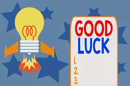 Writing note showing Good Luck. Business concept for wish positive fortune or happy outcome that a demonstrating can have Top view launching bulb rocket fire base Project Fuel idea 版權商用圖片