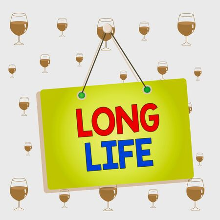 Text sign showing Long Life. Business photo showcasing able to continue working for longer than others of the same kind Colored memo reminder empty board blank space attach background rectangle