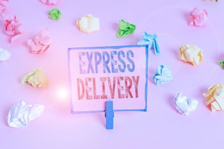 Word writing text Express Delivery. Business photo showcasing expediting the distributiuon of goods and services Colored crumpled papers empty reminder pink floor background clothespin