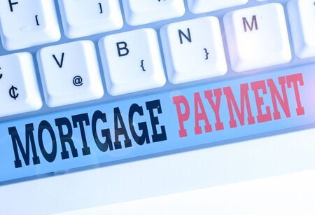 Text sign showing Mortgage Payment. Business photo text periodic amount paid to a holder for repayment of a loan Фото со стока