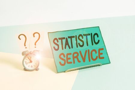 Writing note showing Statistic Service. Business concept for economic statistics which detail international trade Alarm clock beside a Paper sheet placed on pastel backdrop