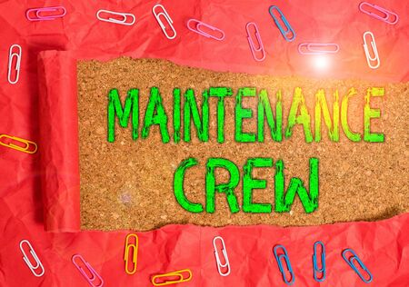 Conceptual hand writing showing Maintenance Crew. Concept meaning responsible for maintenance and repair work of buildings Paper clip and torn cardboard on wood classic table backdrop