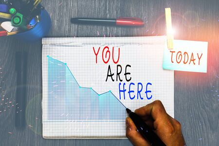 Writing note showing You Are Here. Business concept for This is your location reference point global positioning system