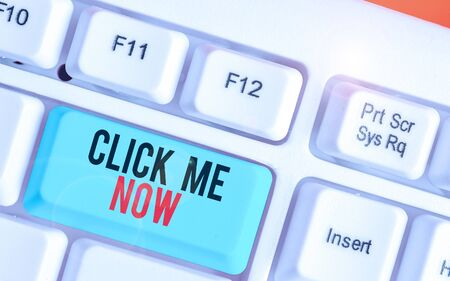 Writing note showing Click Me Now. Business concept for Internet helping desk Press the button Online Icon Nertwork Reklamní fotografie