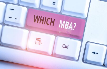 Conceptual hand writing showing Which Mbaquestion. Concept meaning asking for master s is degree in business administration White pc keyboard with note paper above the white background Foto de archivo