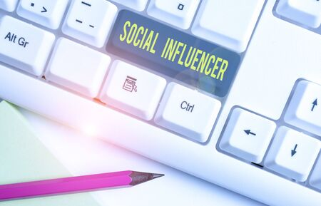 Conceptual hand writing showing Social Influencer. Concept meaning persuade others by virtue of their authenticity and reach White pc keyboard with note paper above the white background