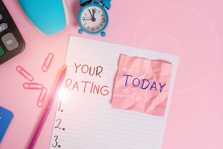 Text sign showing Your Rating. Business photo showcasing score or measurement of how good or popular a demonstrating is Calculator clips clock clipboard mouse sheet note pencil color background