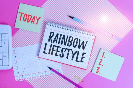 Text sign showing Rainbow Lifestyle. Business photo showcasing same sex couple or individual within the LGBT community Writing equipments and computer stuffs placed above colored plain table