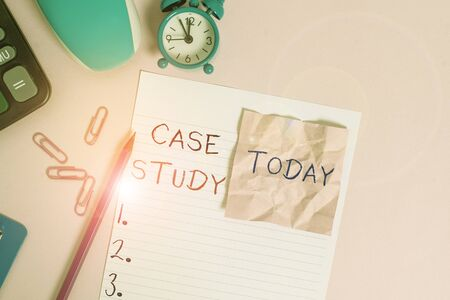 Text sign showing Case Study. Business photo showcasing research methodology that has commonly used in social sciences Calculator clips clock clipboard mouse sheet note pencil color background Zdjęcie Seryjne
