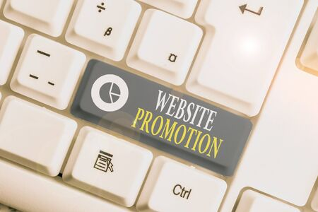 Word writing text Website Promotion. Business photo showcasing increase exposure of a website to bring more visitors White pc keyboard with empty note paper above white background key copy space