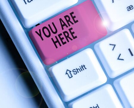 Conceptual hand writing showing You Are Here. Concept meaning This is your location reference point global positioning system