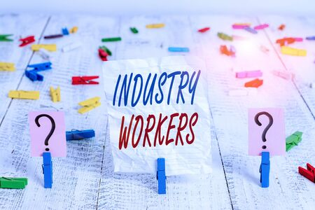 Handwriting text Industry Workers. Conceptual photo one that works especially at analysisual or industrial labor Scribbled and crumbling sheet with paper clips placed on the wooden table