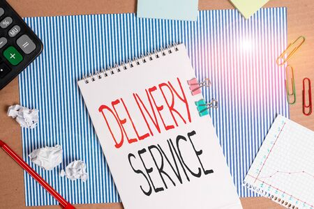 Writing note showing Delivery Service. Business concept for the act of providing a delivery services to customers Striped paperboard notebook cardboard office study supplies chart paper