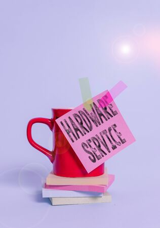 Writing note showing Hardware Service. Business concept for act of supporting and maintaining computer hardware Cup colored sticky note banners stacked pads lying pastel background