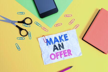 Text sign showing Make An Offer. Business photo text Proposal Bring up Volunteer Proffer Bestow Bid Grant Paper sheets pencil clips smartphone scissors notebook colored background 版權商用圖片