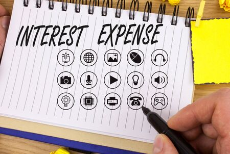 Handwriting text writing Interest Expense. Conceptual photo cost of debt that has occurred during a period of time