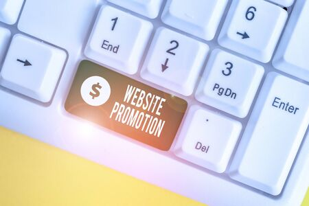 Handwriting text writing Website Promotion. Conceptual photo increase exposure of a website to bring more visitors White pc keyboard with empty note paper above white background key copy space