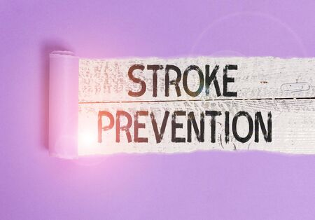Writing note showing Stroke Prevention. Business concept for identified demonstratingal risk factors and change lifestyle Cardboard which is torn placed above a wooden classic table