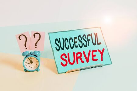 Writing note showing Successful Survey. Business concept for measure of opinions or experiences of a group of showing Alarm clock beside a Paper sheet placed on pastel backdrop
