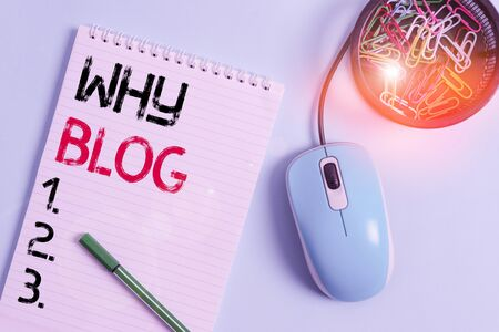 Text sign showing Why Blog. Business photo showcasing reason why regularly records their thoughts or experiences Notebook and writing equipment with computer mouse above pastel backdrop