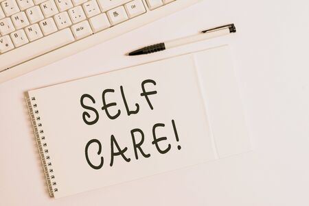 Conceptual hand writing showing Self Care. Concept meaning practice of taking action preserve or improve ones own health White pc keyboard with note paper above white background Archivio Fotografico - 135270068