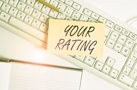 Word writing text Your Rating. Business photo showcasing score or measurement of how good or popular a demonstrating is White pc keyboard with empty note paper and paper clips above white background 版權商用圖片