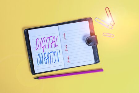 Conceptual hand writing showing Digital Curation. Concept meaning maintenance collection and archiving of digital assets Dark leather locked diary striped sheets marker colored background