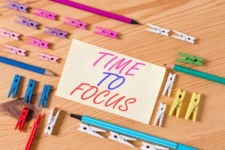 Handwriting text Time To Focus. Conceptual photo Give full attention to something or activity Key to success Colored clothespin papers empty reminder wooden floor background office