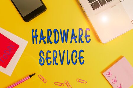 Text sign showing Hardware Service. Business photo text act of supporting and maintaining computer hardware Laptop smartphone notepad marker paper sheet note clips colored background