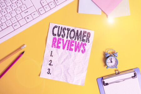 Text sign showing Customer Reviews. Business photo text review of a product or service made by a customer Copy space on notebook above yellow background with keyboard on table