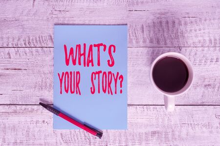 Writing note showing What S Is Your Story question. Business concept for being asked by someone about my own journey Stationary placed next to a cup of black coffee above the wooden table Stock fotó