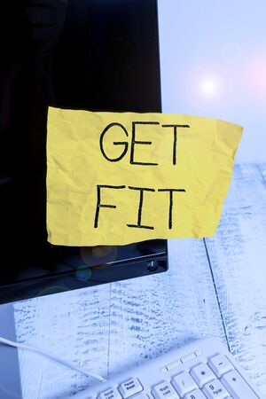 Writing note showing Get Fit. Business concept for right size or shape for someone or something keep your body healthy Notation paper computer monitor screen near white keyboard Stock fotó
