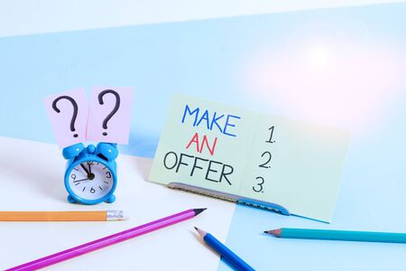 Text sign showing Make An Offer. Business photo text Proposal Bring up Volunteer Proffer Bestow Bid Grant Mini size alarm clock beside stationary placed tilted on pastel backdrop 版權商用圖片