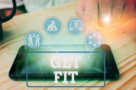 Text sign showing Get Fit. Business photo showcasing right size or shape for someone or something keep your body healthy Stock fotó