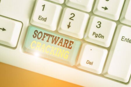 Writing note showing Software Cracking. Business concept for modification of software to remove or disable features